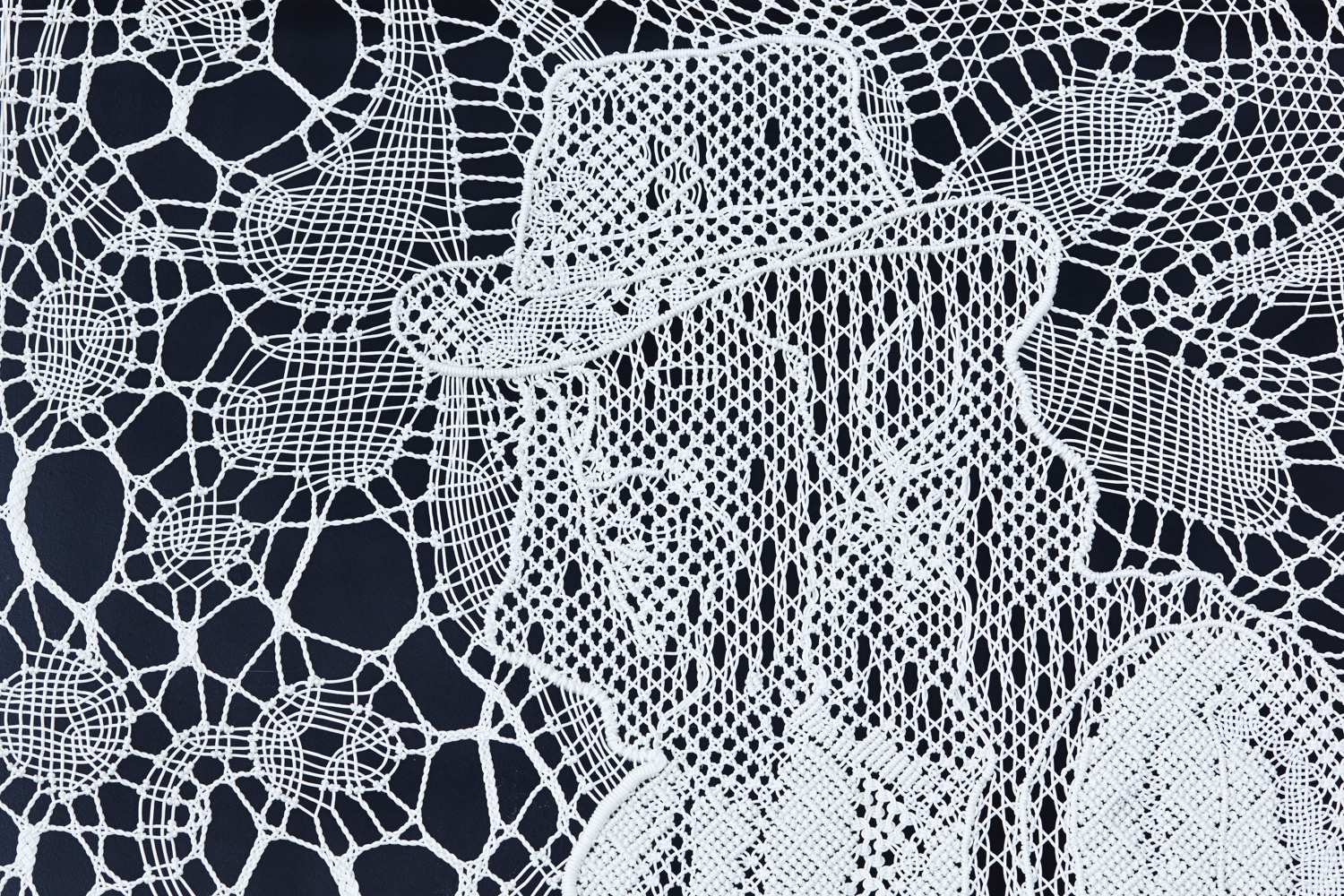 Pierre Fouché. Brett posing for an imaginary portrait of Raymond Buys (2015). Bobbin lace and macramé in polyester braid. 265 x 140cm. Private collection.
